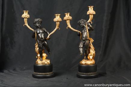 Ein paar feuervergoldete französische empire leuchter aus bronze