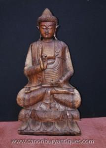 Geschnitzte tibetischen Buddha-Statue in Lotus Pose Buddhismus Buddhistische Kunst